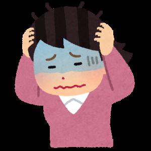 困って頭を抱える女性